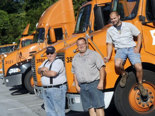 From left: Walt Lighty, Jr., his son, Walt Lighty III and grandson, Walt Lighty IV pose for a photo at A. Duie Pyle in Manchester Township, where all three are truck drivers.