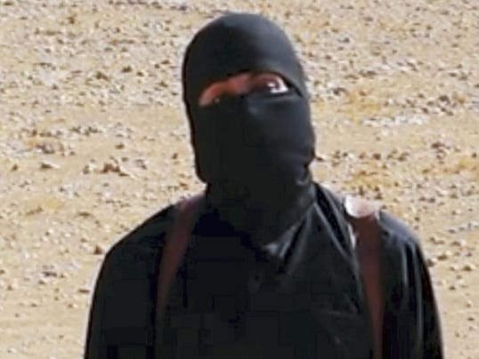 """FILE - This still image from undated video released by Islamic State militants on Oct. 3, 2014, purports to show the militant known as Jihadi John. A U.S. drone strike targeted a vehicle in Syria believed to be transporting the masked Islamic State militant known as """"Jihadi John"""" on Thursday, Nov. 12, 2015, according to American officials. Whether the strike killed the British man who appears in several videos depicting the beheadings of Western hostages was not known, officials said. (AP Photo/File)"""