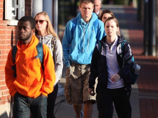 University of Delaware students wait to cross Main St. Monday morning Newark.