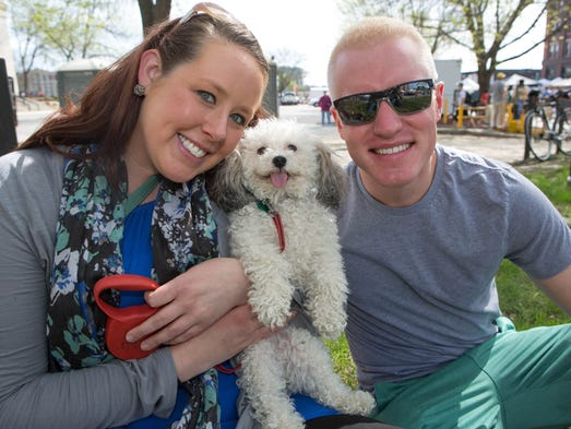 Kristen McLain, 29, of Des Moines, her dog Reggie Miller, and Tim Frank, 26, of Tuscon, Ariz., Saturday, May 3, 2014, during the Farmer's Market in downtown Des Moines.