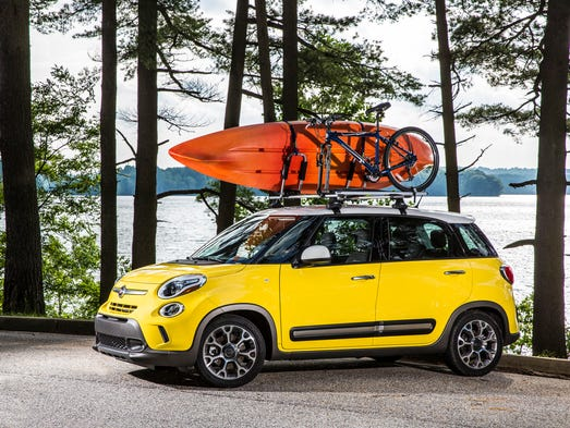 To make sure your road trip goes smoothly, include a car checkup in your travel preparations. It can save hassle and money during and after your vacation. Pictured is a trip-happyFiat 500L Trekker with160-horsepower 1.4-liter engine that delivers up to 33 mpg highway.