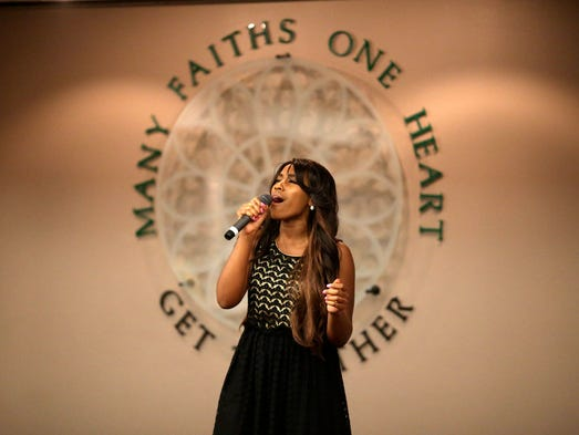 Chanson Calhoun performs before the Festival of Faiths Interfaith Service: A Call to Prayer at the Cathedral of the Assumption. May 13, 2014