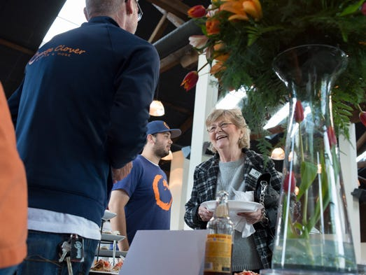 Bonnie Poore chats with Orange Clover's general manager Mike Hall as she samples food at Taste of Jeffersonville in Kye's. Sean Espinal is pictured in the back. Over 20 restaurants participated in the event. May 15, 2014.