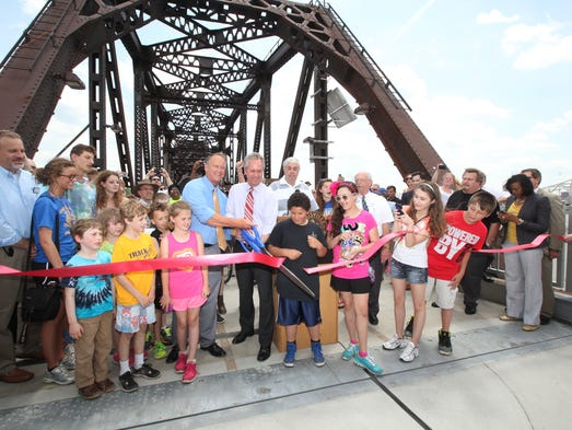 Louisville Mayor Greg Fischer, right, and Jeffersonville Mayor Mike Moore, left, formally cut the ribbon opening Indiana approach to the Big Four Pedestrian Bridge. May 20, 2014