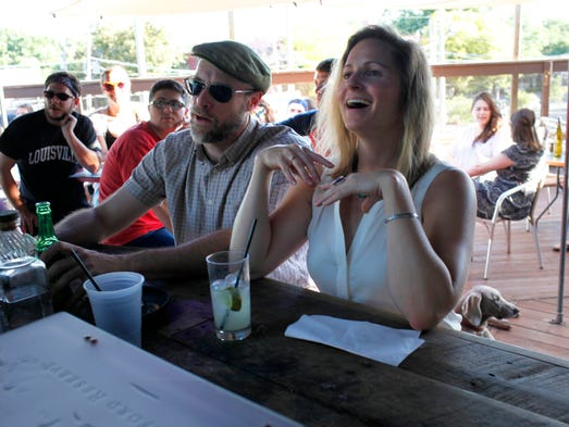 Heather Cash, right, and Matt Hendricks react to the Chile vs. Australia match while watching with friends from left, Katie Rittenhouse, Alyssa Lowery and Nina Webb at The Monkey Wrench on the opening day of the FIFA World Cup soccer tournament. The Monkey Wrench is open early for lunch every day of the World Cup for fans to watch at the bar and is featuring a World Cup inspired menu.   June 13, 2014