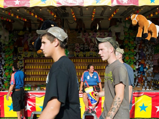 Sally Blauvelt, center, looks out for customers at the Bullitt  County Fair. June 17, 2014.