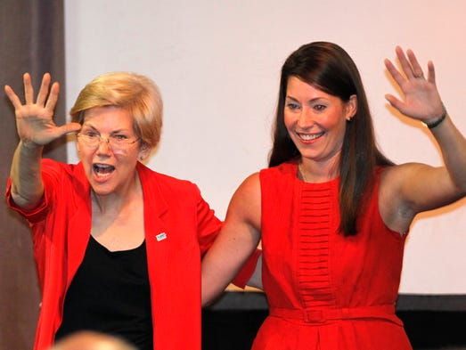 Sen. Elizabeth Warren (L) (D-Mass.) and Democratic U.S. Senate nominee Alison Lundergan Grimes (R) wave to the crowd during a campaign rally for higher education and making college affordable for students at the Red Barn on the campus of the University of Louisville in Louisville, Kentucky.       June 29, 2014