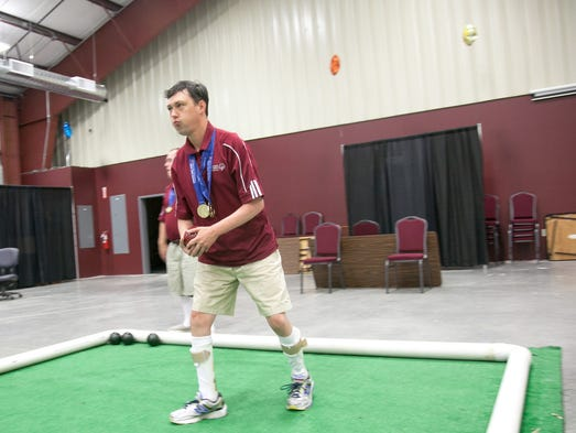 Mike Willard, a team and single Special Olympics gold medalist in bocce ball, gets ready to roll the ball during practice. July 3, 2014