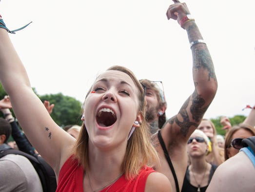 Elissa Perrigan cheers during the Jalin Roze performance at the WFPK Port Stage. July 19, 2014