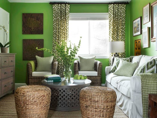 This photo provided by Brian Patrick Flynn/HGTV.com shows a living room designed for Dwell with Dignity by Flynn where he uses neutral accents to tone down the highly energetic tone of apple green wall paint.
