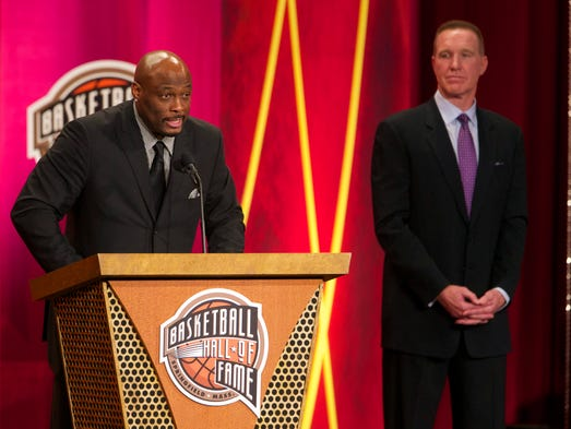 Six-time NBA All-Star Mitch Richmond, left, accepts his induction into the Basketball Hall of Fame while ex-teammate and fellow Hall of Famer Chris Mullin, who inducted him, watches. The Basketball Hall of Fame inducted its 2014 class Friday. Click through for more photos.