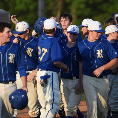 Riverside's Lee Derryberry is greeted by teammates
