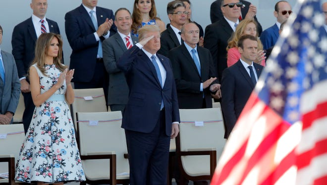 French President Emmanuel Macron, President Trump and first lady Melania Trump watch the traditional Bastille Day military parade on the Champs Elysees, in Paris, on July 14, 2017.