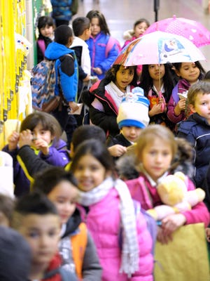 Students wait in the Annex hallway for the school day's end at Academy of the Americas Immersion School in Southwest Detroit. .