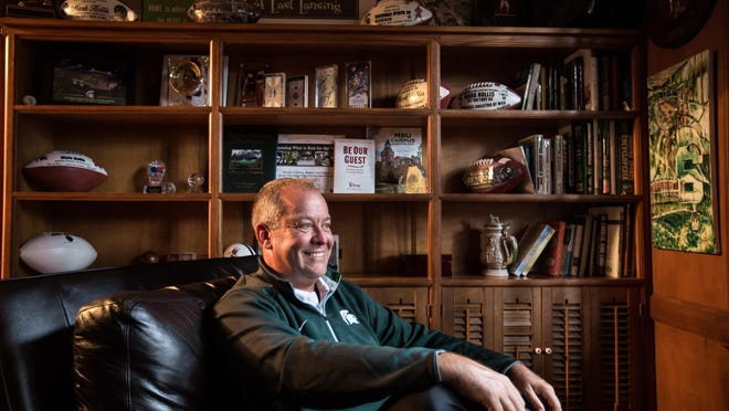 Michigan State University Athletic Director Mark Hollis poses for a photo at his home in East Lansing on Thursday August 20, 2015.