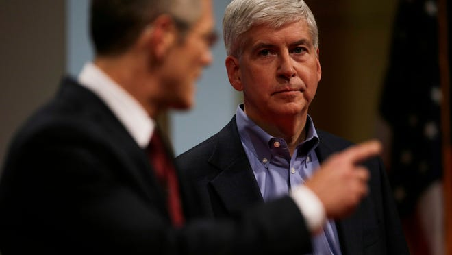 Republican Gov. Rick Snyder and Democratic challenger Mark Schauer talk during a town hall forum  moderated by Detroit News Editorial Page Editor Nolan Finley and the Detroit Free Press Editorial Page Editor Stephen Henderson at the Old Main in Detroit, MI on Sunday, October 12, 2014