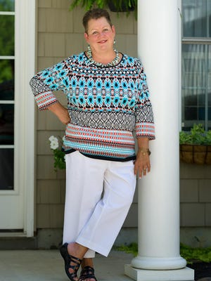 Cindy Small of Dover wears white capris by Chaps; a red, white, navy and turquoise three-quarter sleeve top by Ruby Road Woman; and navy sandals by Naturalizer.