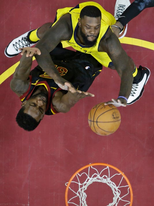 Indiana Pacers' Lance Stephenson, top, drives to the basket against Cleveland Cavaliers' Jeff Green in the second half of Game 1 of an NBA basketball first-round playoff series, Sunday, April 15, 2018, in Cleveland. The Pacers won 98-80. (AP Photo/Tony Dejak)