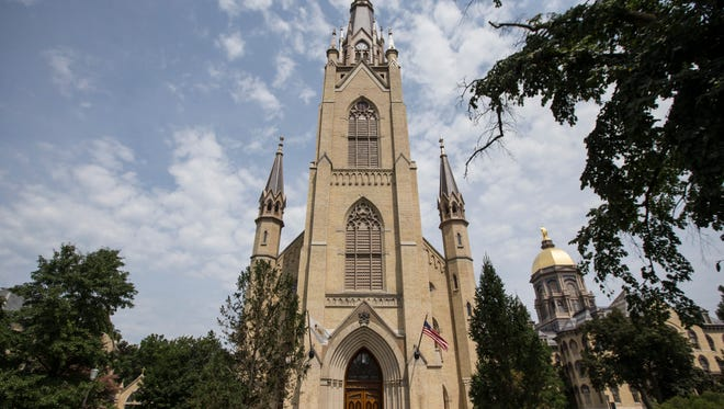 In this Monday Aug. 12, 2013 photo, the Basilica of the Sacred Heart sits on the campus of the University of Notre Dame in South Bend, Ind.