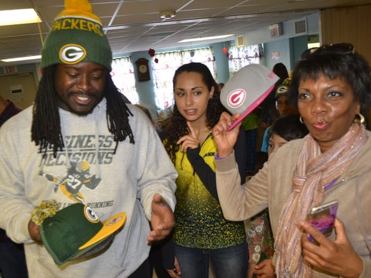 636270859467577480-Eddie-Lacy-hats-giveaway-at-Freedom-House-with-Robyn-Davis-10-17-15-photo-2.jpg