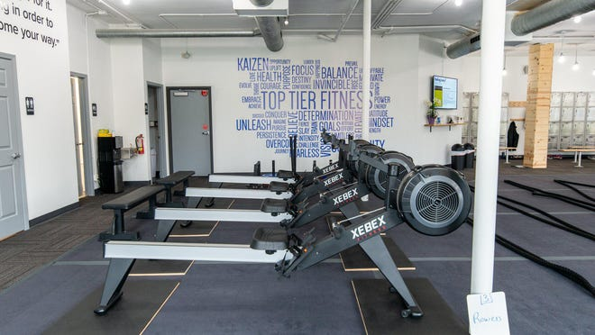 Exercise equipment awaits use at Top Tier Fitness in Holland. Owners Nick and Lark Robinson announced they would not reopen the fitness center following state-mandated shutdown on Thursday, Sept. 3.