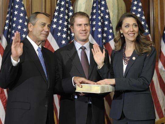 House Speaker John Boehner of Ohio, left, performs