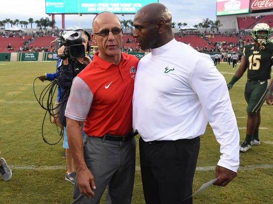 South Florida coach Charlie Strong with Stony Brook