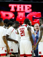 Rutgers Scarlet Knights head coach Steve Pikiell talks to players before start of game