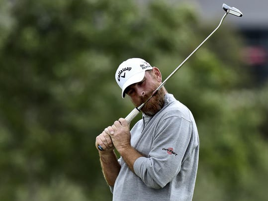 Thomas Bjoern of Denmark bites his club, during the first round of the Made in Denmark golf tournament, in Himmerland, Denmark, Thursday, Aug. 14, 2014. (AP Photo/Polfoto, Rene Schutze) DENMARK OUT