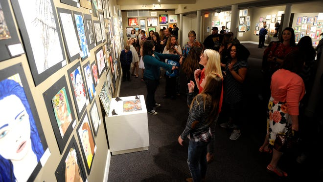 Young artists and their families tour the art on display during the opening reception for the Youth Art Month exhibit Thursday, Feb. 23, 2017, at The Grace Museum. More than 800 works are on display by elementary, middle and high school students from Abilene and the Big Country. Reporter-News writer Janet Van Vleet was impressed by the skill and creativity seen in the pieces; see her column on Page 1B.