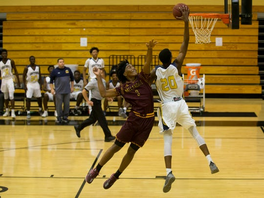 Lehigh's Mo Goin slams a fast-break dunk as Hallandale's Jahvon Smith contests during a first-round game of the Gulfshore Holiday Hoopfest at Golden Gate High School Wednesday. Lehigh won 74-68.