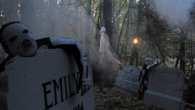 Austin Reeths, foreground, and Garrett Geyer, back, spook those walking through a fog-filled cemetery at dusk at the 2014 Haunted Mansion at Quietwood South Camping Resort in Brussels.