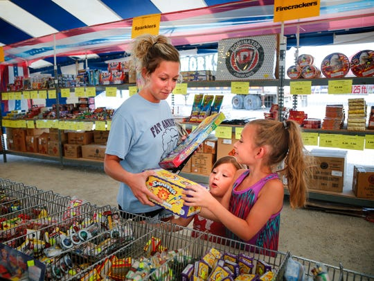 Kelsie Dommer of Woodburn buys fireworks in South Lineville,