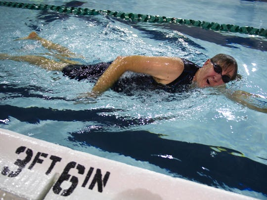 James Childers of Princeton, Ind., competes in the swimming portion of the YMCA Indoor Triathlon at the downtown facility Sunday morning.