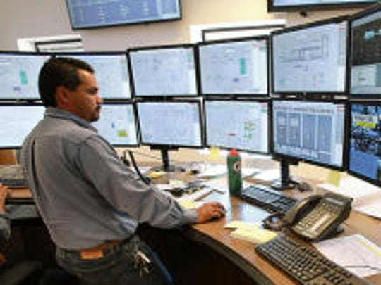 Pete Flores,  superintendent of El Paso Electric's Montana Power Station, viewed monitors in the power plant's control room. The electric company is seeking a rate increase in New Mexico and El Paso.