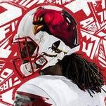 New Cardinal bird logo on side of Adidas Louisville helmet