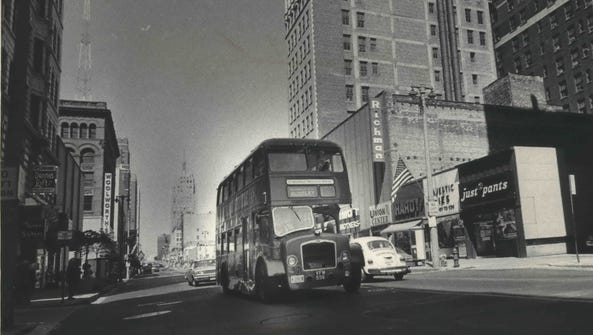 A Midland National Bank double-decker bus cruises down