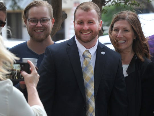 Wichita Falls District 4 City Councilor Jesse Brown, center, poses for pictures shortly before announcing his run for Wichita County Treasurer Tuesday morning. Brown, who is looking to unseat long-time Treasurer Bob Hampton, became the young city councilor in Wichita Falls history to be elected into office.