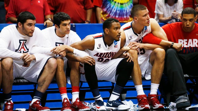 Arizona players watch as the Wildcats take a shot to win the game in overtime against Wisconsin in the NCAA West Regional Final on Saturday, March 29, 2014 at the Honda Center in Anaheim.