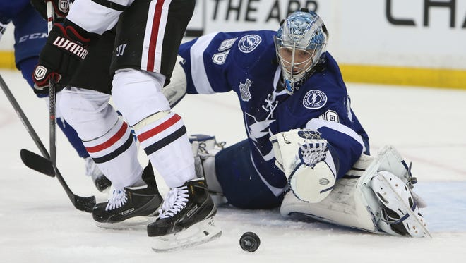 Tampa Bay Lightning goalie Andrei Vasilevskiy (88) reaches for the puck against the Chicago Blackhawks in the third period in game two of the 2015 Stanley Cup Final at Amalie Arena.