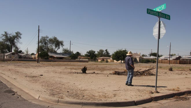 Roger Parker, a community garden committee member and Otero County Master Gardener, looks out at the vacant lot opposite Grace United Methodist Church that will soon house Alamogordo's community garden.