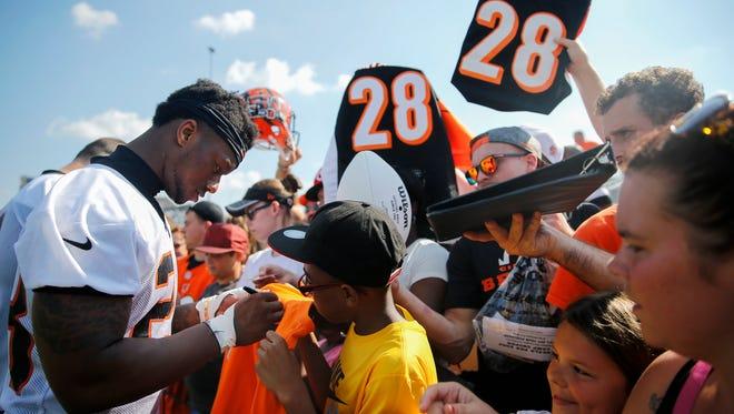Cincinnati Bengals rookie running back Joe Mixon (28) signs autographs for fans at the end of Cincinnati Bengals training camp practice, Friday, July 28, 2017, on the practice fields next to Paul Brown Stadium in Cincinnati.