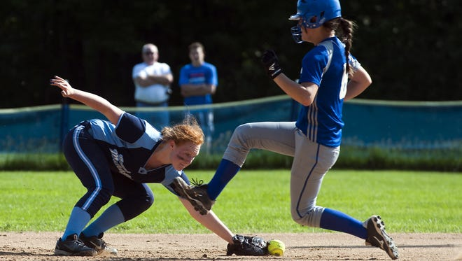 MMU's Danielle Bushey (12) dives for the ground ball as Colchester's Alli Sheets (6) runs during a Division I high school softball quarterfinal game Friday.
