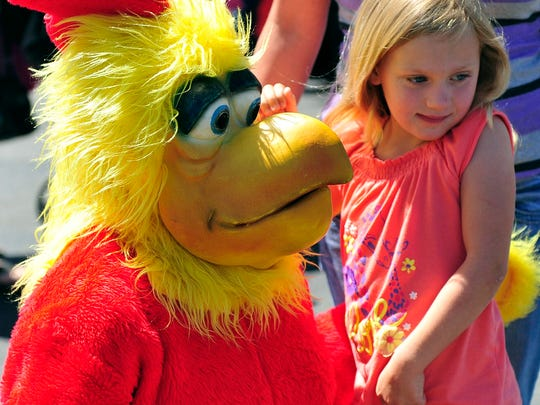 Avary Roe was a little shy with the real Spring Chicken but she and her family enjoyed a chicken dinner with all the trimmings during Sunday's annual Spring Chicken Affair. This year volunteers fried enough chicken to feed about 5,000 people during the event. The event benefits West Texas Rehabilitation Center. shot/archived 04.19.15