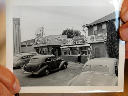 In 2010, Dog House owner Lou Sloan helds a photo of The Dog House when it opened in the early 1950s.