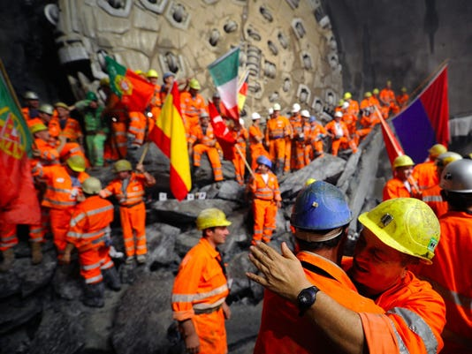 Miners hug after a giant drilling machin