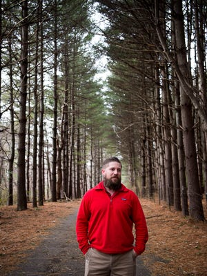 Josh Harrold, Black Mountain's planning and development services director, stands among the trees lining the Black Mountain stretch of the Fonta Flora Trail that once completed, will stretch from Morganton to Asheville.