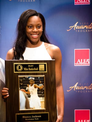 Alabama Miss Basketball Bianca Jackson, of Brewbaker Tech, holds up her award during the Alabama Sports Writers Association Mr. and Miss Basketball banquet on Tuesday, April 4, 2017, at the Renaissance Hotel in Montgomery, Ala.