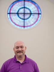 Rev. Reed DePace stands inside First Presbyterian on