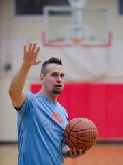 Matt Bostic stands inside the Wilson YMCA on Wednesday, Aug. 30, 2017, in Montgomery, Ala. Bostic set a new world record for the most free throws in a 24-hour period with 20,500 free throws made at the Wilson YMCA.